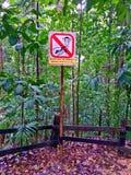 "Signpost saying ""Do not feed the monkeys"" Stock Photo"