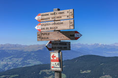Signpost at Seiser Alm directing to hiking and running trails Royalty Free Stock Photos