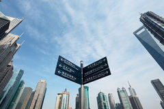 Signpost in shanghai. Signpost with shanghai skyline of the lujiazui financial center at daytime royalty free stock photos