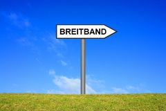 Signpost showing Broadband german. Signpost outside is showing Broadband in german language stock photography