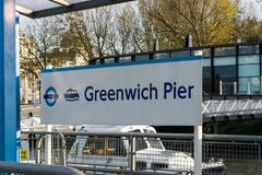 The signpost showing the dockside at Greenwich pier Sign for Greenwich Pier. stock images