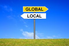 Signpost showing Global and Local. Signpost outside is showing Global and Local Royalty Free Stock Images