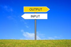 Signpost showing Input Output. Signpost outside is showing Input and Output Stock Photography