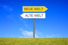 Signpost showing New World Old World german. Signpost outside is showing New World Old World in german language Stock Photo