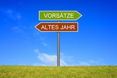 Signpost showing Old Year and Intentions german. Signpost outside is showing Old Year and Intentions in german language stock images