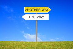 Signpost showing One Way or Another Way. Signpost outside is showing One Way or Another Way stock photos
