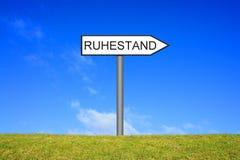 Signpost showing Retirement german Stock Images