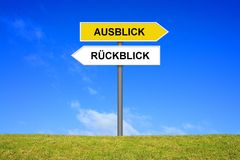 Signpost showing Review and Vision german. Signpost outside is showing Review and Vision in german language Royalty Free Stock Photos