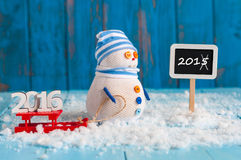 Signpost showing strikethrough year 2015 and Stock Photos