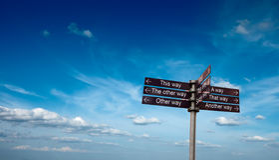 Signpost in sky Stock Photos