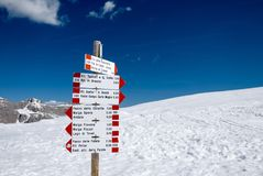 Signpost in snowy Alpine mountains - Madonna di Campiglio ski ce. Nter in Italy Royalty Free Stock Photography