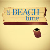 Signpost with the text on beach time, with a retro look Royalty Free Stock Photography
