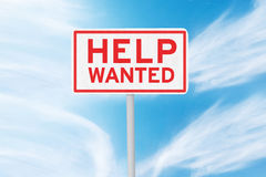 Signpost with text of Help Wanted. Image of a text of Help Wanted on the signpost under clear sky Stock Photography