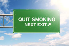 Signpost with text of quit smoking Stock Photo