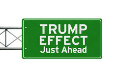 Signpost with text of Trump Effect. Image of a green signpost with text of Trump Effect just ahead, isolated on white background. Symbolizing Trump Effect in the Royalty Free Stock Photo