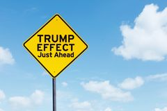 Signpost with text of Trump Effect Just ahead. Picture of yellow signpost with text of Trump Effect Just ahead under blue sky Royalty Free Stock Images