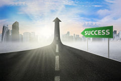 Signpost to success on the street upward Royalty Free Stock Photo
