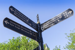 Signpost to the world famous museums of Amsterdam. Signpost in the center of Amsterdam directing to the world famous museums like the Rijksmuseum and the Van Stock Image