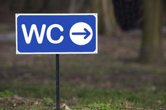 The signpost toilet. On a blurred background royalty free stock photography