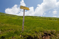 Signpost on trail in front Royalty Free Stock Photography