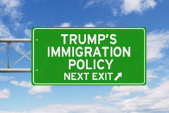 Signpost with Trump Policy under blue sky Stock Photo