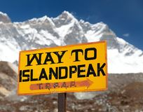 Signpost way to Island peak under Lhotse peak Royalty Free Stock Images