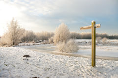 Signpost in winter Royalty Free Stock Images
