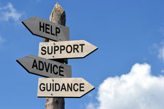 Signpost (wooden) - help, support, advice, guidance Royalty Free Stock Photo