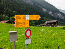 Signpost written in German tells various hiking trail directions, Grindelwald, Switzerland. All German names are specific places. Signpost written in German Royalty Free Stock Images