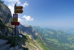Signposted trail. Signpost in the Alps along an Alpine trail Stock Photos