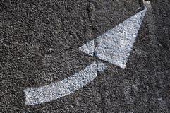 Signposting. Turn signal white painted on asphalt royalty free stock image