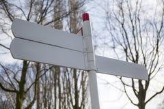 Signpostnpointing i tre olika riktningar Royaltyfri Fotografi