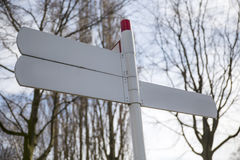 Signpostnpointing in three different directions Royalty Free Stock Photography
