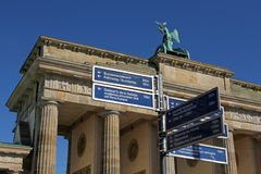 Signposts of Berlin's landmarks with Brandenburg Gate in the background, Berlin, Germany Stock Image