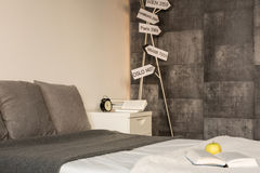 Signposts in contemporary gray bedroom Royalty Free Stock Photos