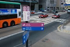 Signposts in hong kong central. Directions of ferry and city all Stock Photography