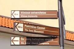 Signposts to tourist attractions in the Old town of Vilnius, Lithuania Royalty Free Stock Photography