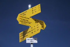 Signs. Yellow tourist signs over blue sky royalty free stock image