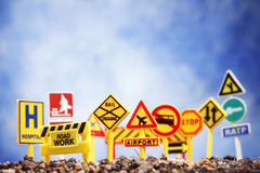 Signs. A bunch of signs stuck in gravel Royalty Free Stock Photo