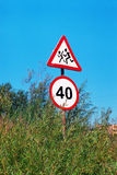 The signs. These signs are standing on Voronezhskaya str. in Khabarovsk, Russia, near the city line in a bush of willow Stock Photo