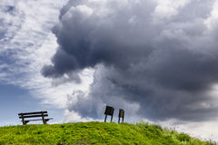 Clouds with signs and a bench Royalty Free Stock Photography