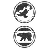 Signs with a bear and an eagle Stock Images