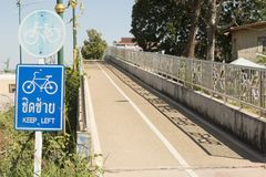 Bicycle path in countryside. Signs for bicycle trail somewhere in the provinces of Thailand Stock Photography