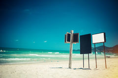 Signs boards on beach. Signs boards on tropical beach Stock Photos