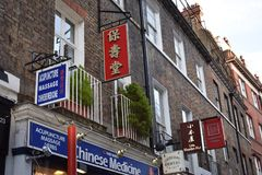 Chinese signs. Signs on buildings in Chinatown, London Royalty Free Stock Photo