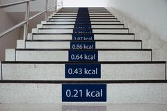 Signs of calories burn on the stairs at office. Healthy stairway for health and diet concept Stock Photography