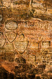 Signs on cave wall Stock Images