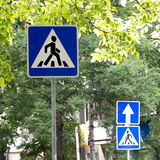 Signs Crosswalk and One-way street outdoors on a clear sunny day Royalty Free Stock Photo