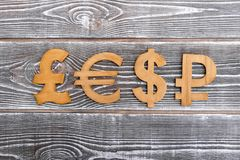 Signs of currencies. On a wooden background. money. conversion.daining signs Stock Images