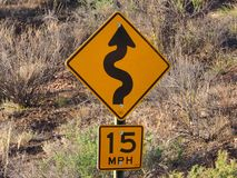Signs:  Curves. Road sign for curves and fifteen mph speed limit Royalty Free Stock Images